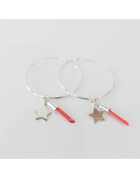 Créoles argent avec étoile et pompon en cuir